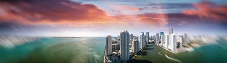 Miami Downtown and Brickell Key aerial view at sunset, Florida - USA.