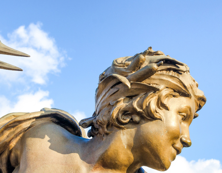Statues of angels on the bridge of Paris in France Pont Alexandre III. Editorial