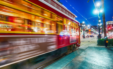 NEW ORLEANS - FEBRUARY 11, 2016: New Orleans streetcar at night, blurred view. The city attracts 15 million tourists every year. Editorial