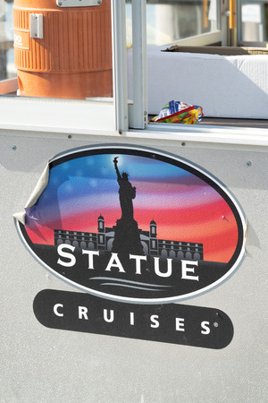 NEW YORK - OCTOBER 2015: Statue Cruises street sign. The city attracts 50 million people annually.