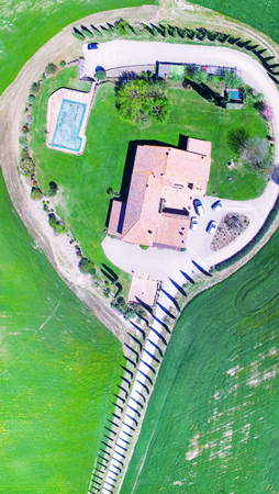 Agriturismo road of cypresses, Tuscany aerial view.