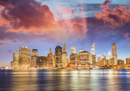 Downtown Manhattan sunset light with river reflections from Brooklyn, New York City. Stok Fotoğraf