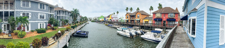 SIESTA BEACH, FL - FEBRUARY 2016: Panoramic view of colourful homes along canal. Siesta Beach is a famous destination in Florida. Editorial