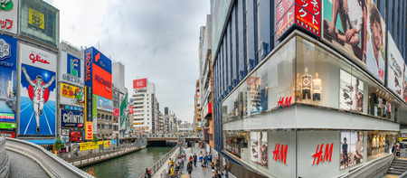 OSAKA, JAPAN - MAY 2016: Panoramic view of Dotonbori district with buildings and ads. This is a famous city attraction for tourists.