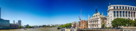 LONDON - MAY 2013: City skyline from Blackfriars Bridge. London attracts 30 million people worldwide annually.
