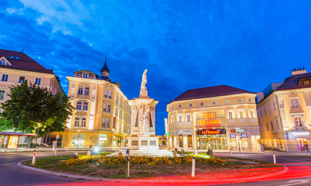 KLAGENFURT, AUSTRIA - AUGUST 21, 2013: Main square at night. Klagenfurt is a major destination in Austria. Editoriali