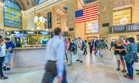 NEW YORK CITY - JUNE 10, 2013: Tourists and locals in Grand Central Main Hall. This is a major hub for New York transportation system.