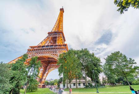 PARIS - JULY 2014: Eiffel Tower illumination. Paris attracts 40 million visitors annually.