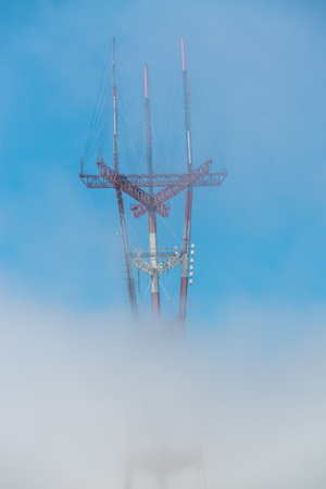 Electric tower shrouded by fog. Stock Photo