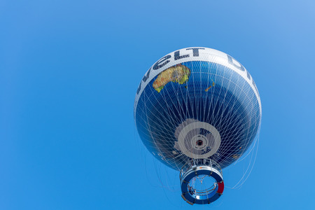 BERLIN - JULY 24, 2016: Air Service Berlin operate the World Balloon Berlin with Die Welt advertising. The helium balloon takes passengers up to 150 meters above the city.