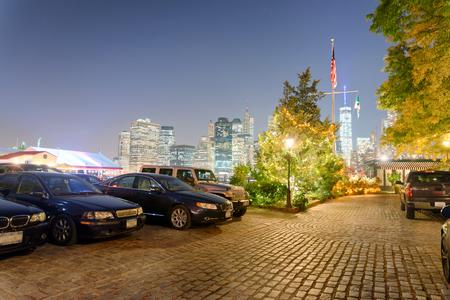 Lower Manhattan night skyline as seen from Brooklyn Bridge Park - New York.