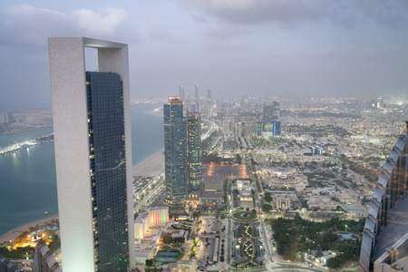 Aerial view of Corniche Road buildings at night, Abu Dhabi. Stock Photo