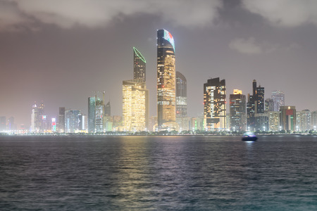 Reflections of Corniche Road buildings at night as seen from Marina, Abu Dhabi.