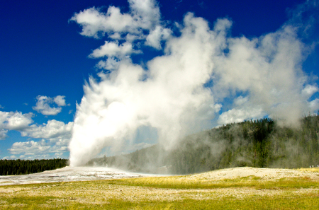 The Famous Old Faithful Geyser in Yellowstone National Park Stock Photo