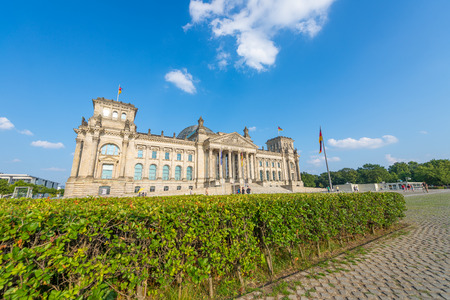 BERLIN, GERMANY - JULY 24, 2016: Beautiful view of Reichstag surrounded by gardens. Berlin attracts 20 million people annually. Editorial