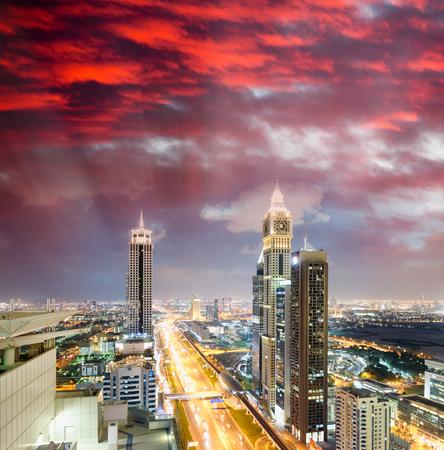 Downrtown skyline along Sheikh Zayed Road at night, Dubai.