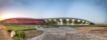 ABU DHABI, UAE - DECEMBER 6, 2016: Panoramic sunset view of Ferrari World. It is a famous tourist attraction in the city.