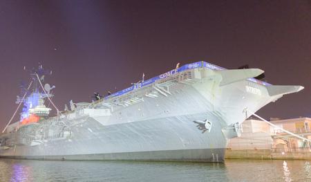NEW YORK CITY - JUNE 14, 2013: USS Intrepid (CVCVACVS-11), is one of 24 Essex-class aircraft carriers built during World War II.