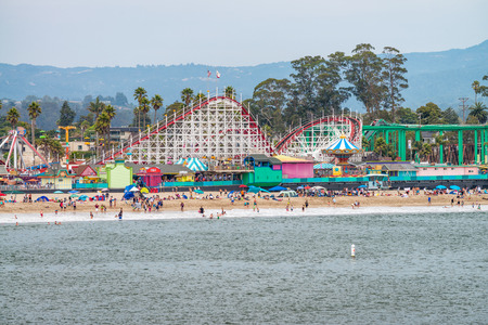 SANTA CRUZ, CA - AUGUST 4, 2017: People at Amusement Park on the beach. Santa Cruz is a famous tourist destination in California.