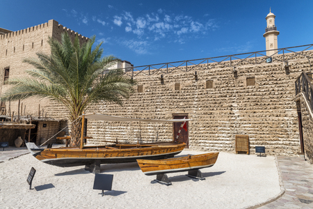 Dubai Museum with wooden boats on a beautiful sunny day, UAE.