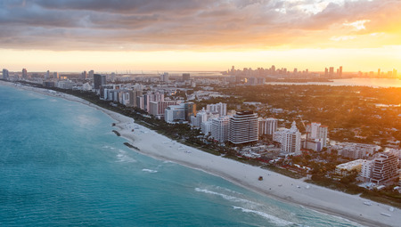 Sunset skyline of Miami Beach, aerial view.