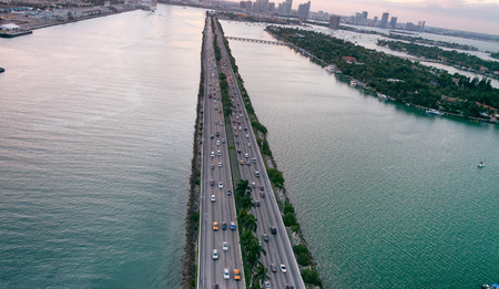 Aerial sunset view of MacArthur Causeway in Miami, Florida.