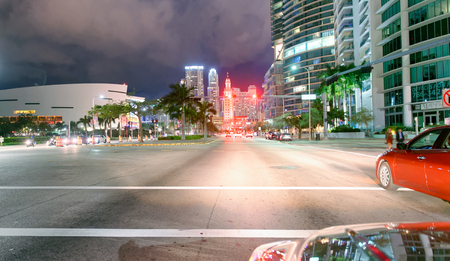 MIAMI - FEBRUARY 27, 2016: City traffic at night in Downtown. Miami attracts 25 million visitors annually.
