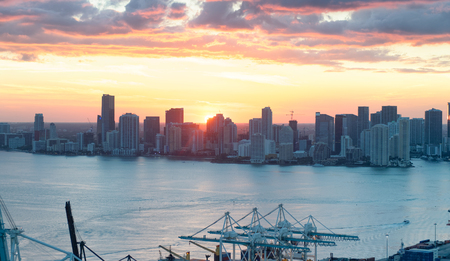 Aerial view of Downtown Miami buildings at sunset.
