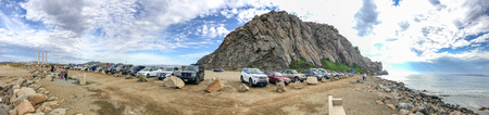 MORRO ROCK, CA - AUGUST 2, 2017: Tourists enjoy Morro Rock landscape. It is a major attraction in California. Éditoriale