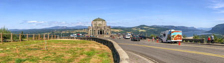 PORTLAND, OR - AUGUST 19, 2017: Tourists enjoy panoramic view of Columbia river gorge from Vista House. It is a famous attraction in Oregon.