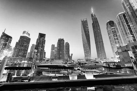DUBAI, UAE - DECEMBER 5, 2016: Dubai Marina buildings and sunset city lights. Dubai attracts 30 million tourists annually. Editorial