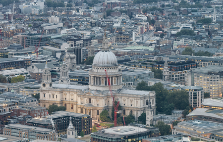 Aerial view of St Paul and city skyline at night, London.