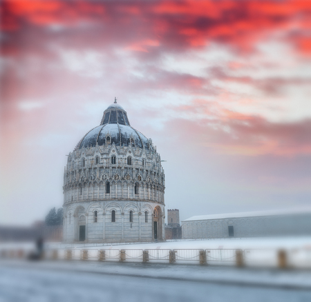Square of Miracles with Baptistery detail at dusk after a winter snowfall, Pisa - Italy.