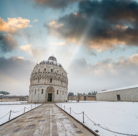 Baptistery of Pisa after a winter snowfall at sunset. Square of Miracles at dawn.