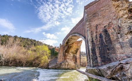 Wonderful ancient bridge over a creek.