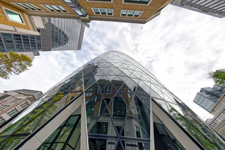 LONDON - SEPTEMBER 25, 2016: Upward view of London City skyscrapers. London attracts 30 million people annually.