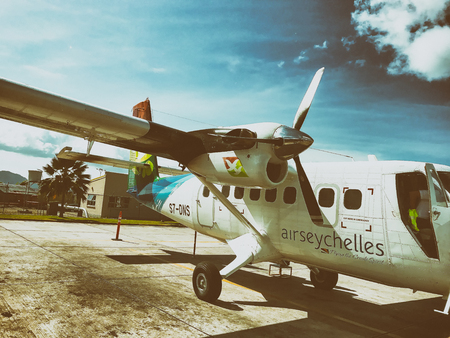 MAHE, SEYCHELLES - SEPTEMBER 4, 2017: Air Seychelles small aircraft on the runway. The company operates flights among the islands.