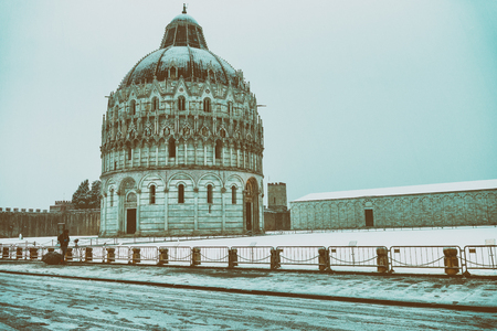 Square of Miracles with Baptistery detail at sunrise after a winter snowfall, Pisa - Italy. Stock Photo