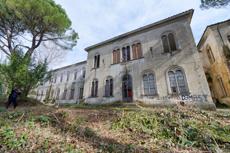 VOLTERRA, ITALY - FEBRUARY 24, 2018: Exterior view of Charcot building. It is part of the of abandoned asylum, closed in 1984. Editorial