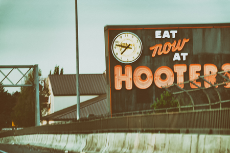 PORTLAND, OR - AUGUST 21, 2017: Hooters sign on the highway. Hooters is the trade name of two privately held American restaurant chains.