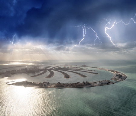 Amazing aerial view of Palm Jumeirah Island in Dubai from helicopter against sunset sky. Banque d'images