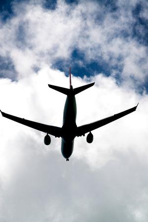 Skyward view of landing plane.
