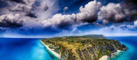 Calabrian coastline in summer season, panoramic aerial view.