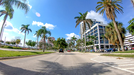 PALM BEACH, FL - APRIL 2018: Traffic along city streets. Palm Beach is a major attraction in Florida.
