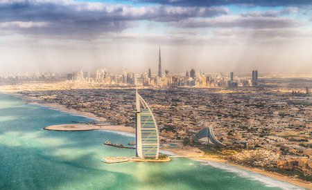 DUBAI, UAE - DECEMBER 10, 2016: Aerial view of Burj Al Arab and city skyline. Dubai attracts 15 million people every year. Editöryel