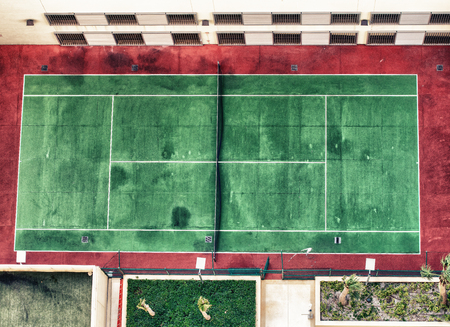 Aerial image of empty outdoor green and red hard tennis court with nets. Zdjęcie Seryjne