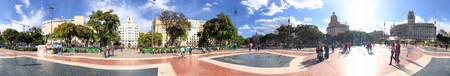 BARCELONA - MAY 14, 2018: Tourists enjoy city streets from Catalunya Square. Barcelona attracts 10 million tourists annually.