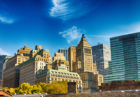 Old and modern skyline of New York City on a sunny autumn day.