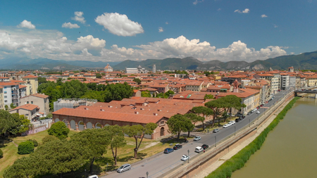 Aerial view of beautiful Lungarni in Pisa. Arno river and medieval buildings, Tuscany.