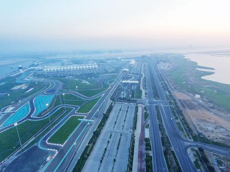Yas Island, Abu Dhabi. Aerial view of city car circuit at dusk, United Arab Emirates. Stock Photo